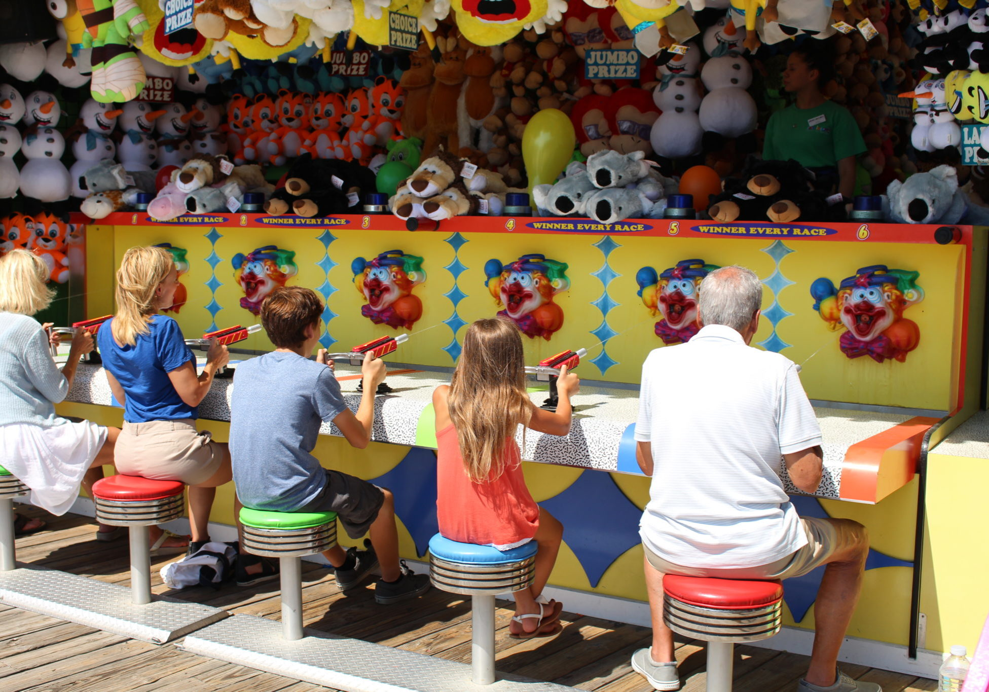 Photo of people playing a boardwalk game.